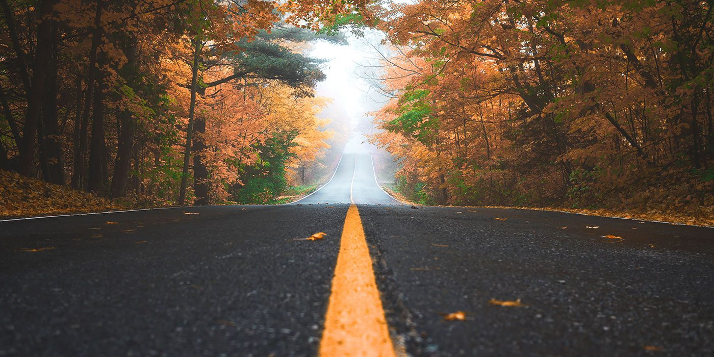 photo of a road with a yellow path